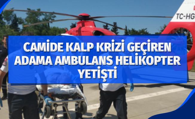 Camide kalp krizi geçiren yaşlı adamın yardımına ambulans helikopter yetişti